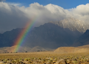 Rainbows all around this week.  Lovely bow in front of Independence Peak.  Photo by Andrew Kirk