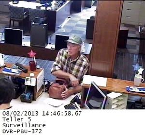 Surveillance footage reveals robbery suspect.