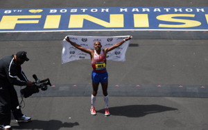 Meb Keflezighi of the US, celebrates after crossing the finish line to win the Men's Elite division of the 118th Boston Marathon in Boston, Massachusetts April 21, 2014 .  (TIMOTHY A. CLARY/AFP/Getty Images)