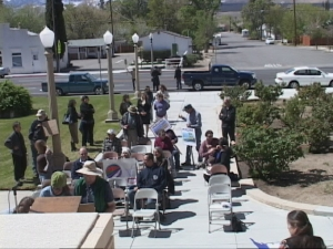 Citizens rallied at a press conference before the Board meeting.