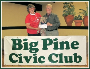 Photo (by Lisa Schade):  Sandy Lund, Big Pine Civic Club President with her Inyo County Animal Shelter adoptee, Charlie; and Ted Schade, ICARE President