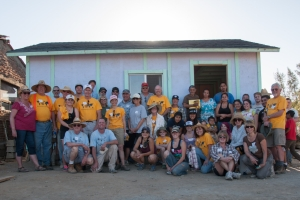 Mammoth volunteers with Andrade family in doorway