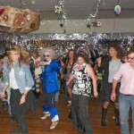 Inyo Supervisor Jeff Griffiths showing his moves on the floor as giant fruitcake threatens to crush other dancers