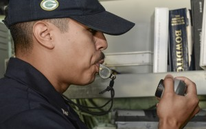 150730-N-TW634-026 DARWIN, Australia (July 30, 2015) Boatswain's Mate 3rd Class Emmanuel Castro, from Lone Pine, Calif., blows a whistle into the 1 main circuit (1MC), or general announcing system, of the amphibious transport dock ship USS Green Bay (LPD 20) to signal the end of colors to the ship's crew. Green Bay is assigned to the Bonhomme Richard Expeditionary Strike Group and is on patrol in the U.S. 7th Fleet area of operations (U.S. Navy photo by Mass Communication Specialist 3rd Class Derek A. Harkins/Released)