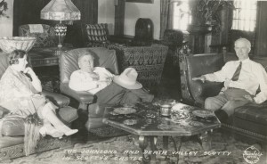 In the living room at Scotty's Castle are businessman Albert Johnson, right, his wife, left, and Death Valley Scotty. The two men formed an unlikely and very interesting partnership that resulted in the construction of the Castle, and Scotty's well-publicized exploits in Death Valley. Photo courtesy Eastern California Museum.