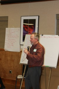 Bishop City Administrator and workshop leader Jim Tatum in front of the long list of concerns and issues facing the local business community.