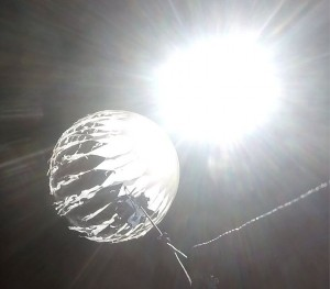 "This photograph entitled ""pop2"" depicts the weather balloon just as it pops."