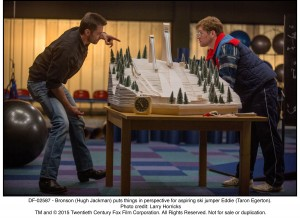 Bronson (Hugh Jackman) puts things in perspective for aspiring ski jumper Eddie (Taron Egerton).