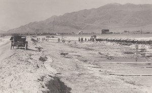 Men working in the evaporation ponds at Natural Soda Products, outside of Keeler, about 1920. Eastern California Museum photo.